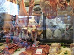 The butcher shop on Arthur Avenue in the Bronx. cool double exposure shot!