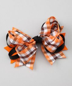 A must-have Orange & Black Plaid Bow in school colors for the upcoming football games!  #zulily #fall