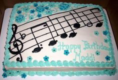 Musical sheet cake...buttercream icing with fondant flowers