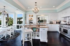 Like the tan countertops with the blue walls. Good alternative to white marble.