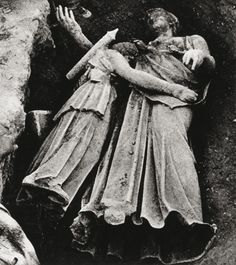 """A photo of the Piraeus Athena and Artemis, which were discovered """"embracing""""in situ during the excavation of the city of Piraeus in July 1959.(Photo: Archive of the Archaeological Society at Athens)"""
