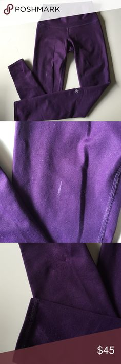ALO Airbrushed Glossy High Waist leggings ALO Airbrushed High Waist leggings in glossy purple pennant color.  Size small. I have worn these multiple times, and they do have a bit of wear on the bottom of hems (from being tucked under my heels during barre), and one spot of white paint (see photos) -- thus the big discounted price. But they are still very nice condition and a fun color that's no longer available! ALO Yoga Pants Leggings