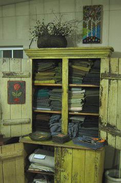 Wool!!  i have a smaller antique dresser full of wool just like this one, neat huh???