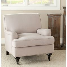 The Nottingham chair takes timeless styling and freshens up with today's colors. This furniture piece features a comfortable wide back cushioning in a beige linen upholstery.