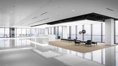Spacemen designed the offices for Asia Financial Center, located in Shanghai, China. Jinggong Group Co Ltd core businesses are in the steel structure Grey Lounge, Office Lounge, Office Interior Design, Office Interiors, Visual Merchandising, Expanded Metal, Cove Lighting, Waiting Area, Business Centre