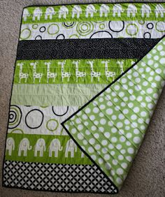 Modern strip quilt for baby. Love the fabrics they used!