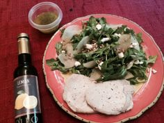 Pork Chops cooked in Lemon Infused Olive oil and Fresh Thyme and THIS salad: http://www.foodandwine.com/recipes/asian-pear-and-arugula-salad-with-goat-cheese Oil was a present from novelist Patti Callahan Henry