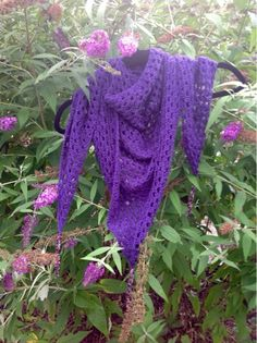 This deep purple shawl is made of a triangular granny square, a simple design, but made so much better with the addition of shiny purple bea...
