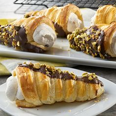 You're sure to impress your guests with these sweet indulgences. Flaky puff pastry cones, dipped in luscious chocolate and filled with an oh-so- easy to whip up cannoli cream. The best part is they can be made ahead of time and assembled just before guests arrive.