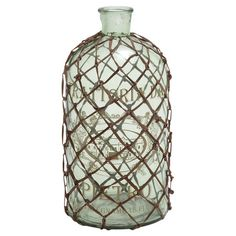 Add artful appeal to your entryway console table or living room mantel with this glass bottle, featuring a vintaged motif and knotted leather-inspired accent...
