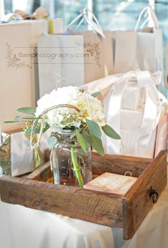 wedding gift table decor:  old drawer, programs, flowers, glass jars, twine  http://www.8amphotography.com