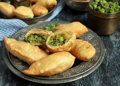 Matar Karanji is an indulgent Maharashtrian snack made using seasonal fresh green peas. Green peas and fresh coconut along with a few other spices are stuffed in a crisp flour pastry and then deep fried till golden brown. Matar Karanji is usually served as a tea time snack but you can make mini bite sized karanjis and serve them as a party appetizer or snack.  Spicy Matar karanji tastes great on its own but you can serve them with Raw Mango & Coconut Chutneyor any chutney of choice.  If you…