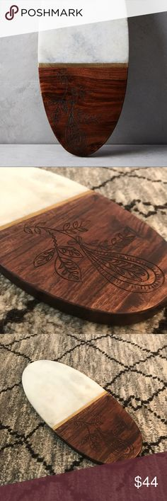 Anthropologie Regione Cheese Board, Marble & Wood SOLD OUT ONLINE!   Anthropologie Regione Cheese Board  •Handmade item, Marble and Sheesham Wood  Super trendy cheese board that could be used in all seasons! This piece is brand new, just taken out of the box. Anthropologie Other
