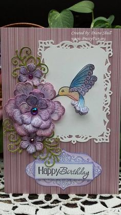Hummingbird stamp by Hot off the press, Flowers from Heartfelt Creations Arianna Blooms Collection, Both colored with Pastels. Card designed by Diane Shull.