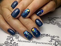 Blue nails with a few dots.
