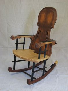 Fiddle Rocker.  As a musician and a woodworker/furniture maker, Thomas Orner combines his love for the two forms of art into one. By building a piece of furniture which is functional and would also be appreciated for its artistic beauty.