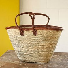 Traditional French Market Basket with leather handles, attachments, and rim. Made in Morocco as all French Market Baskets are made. Renewable resource.