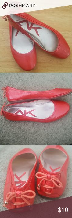 Anne Klein Sport Flats Cute and comfy coral flats! Adorable laced heel detail, rubber sole. These are worn and have little black spots on the inside, but no major defects. Anne Klein Shoes Flats & Loafers