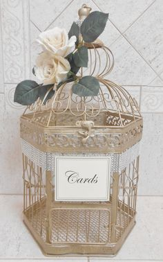 This Extra Large Birdcage Has Been Painted Champagne Gold It Is Decorated With Shimmering Silver Rhinestone Mesh Ribbon Two Ivory Burlap Roses And A