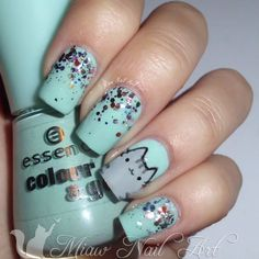 Go glam and adorable all in the same mani. It's a great nail look for cat lovers.