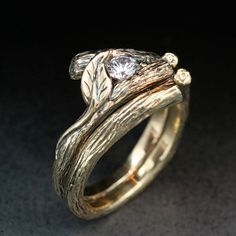 Woodland inspired engagement and wedding band pair.