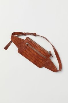 Belt bag in grained faux leather Two main compartments with zip at top and one outer compartment with zip. Cotton twill lining. 1 x 4 x 7 in. Leather Belt Pouch, Small Leather Bag, Handbag Accessories, Women's Accessories, H&m Women, Small Backpack, H&m Gifts, Small Shoulder Bag, Clutch