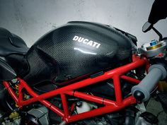 Ducati RTuned carbon fiber petrol tank created by RTuned - Richard Ho Ducati Monster 695, Ducati Monster Custom, Monster 696, Ducati Cafe Racer, Cafe Racers, Ducati S4r, Modern Cafe Racer, Motorcycle Bike, Scrambler