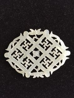 (Qing dynasty) Pierced white Jade Plaque. Qing dynasty, China.                                                                                                                                                      More