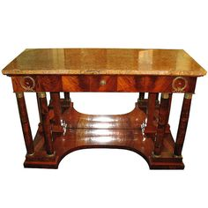 """Biedermeier console table South Germany circa 1810/15 This oversized Biedermeier console table represents one of the 3 main design movements in the Biedermeier furniture style: the classical antiquity influences until 1830/35. Frieze with faux drawer over 2 pairs of Corinthian columns and pilasters. Original French bronze ormolus, original mirrors and original stone plate from the quarries in Kehlheim/Germ. (""""Kehlheimer Platte)."""