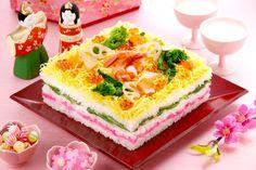 Festive layered chirashi (mixed) sushi shaped like a cake to celebrate Japanese Girl's Day, or Hinamatsuri (Doll Festival).