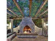 Outdoor Living - the fireplace, seating, and pergola.