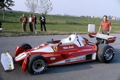 Niki Lauda 1976, perhaps pre season. Before his accident for sure. I like the fenders in front of the wheels, not something that was raced I think.