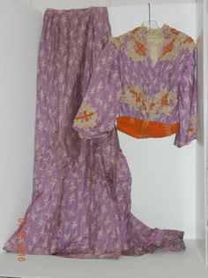 what looks like an edwardian 2 piece purple ensemble with orange detail; although this dress looks rather sad and the photos are not very good I thought the colour combination was very interesting as is the placement of the lace