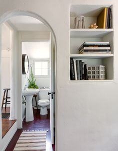 The 1920s home boasts arched doorways and rustic built-in shelving.