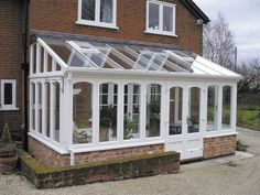 Another lean to conservatory with old brick dwarf wall