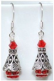 A personal favorite from my Etsy shop https://www.etsy.com/listing/217454682/exquisite-silver-and-swarovski-siam-red