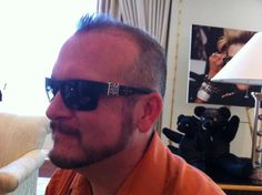 Tim is wearing an awesome wood, silver and diamond frame at the Chrome Hearts suite.