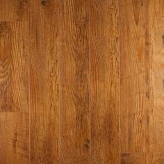 Warm Nutmeg, from the Masterpiece Collection by Artisan Floors, featuring 5-inch wide-plank slightly-textured laminate flooring in many exotic and traditional styles and colors.