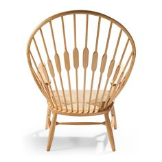 First introduced in 1947, the Wegner Style Peacock Chair's back resembles the feathers of a peacock. The Peacock Chair has a distinct post modern look, making it a captivating addition to any modern home.
