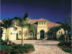 Eplans House Plan: Clearly Mediterranean-inspired, with pavers and barrel-tile roof in terracotta hues and graceful arches and columns, the sun-drenched fa