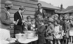 Children line up for a free issue of soup and bread during the Depression c.1932.  Courtesy State Library of New South Wales