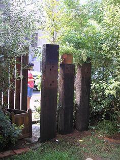 Garden Gates, Garden Art, Garden Ideas, Outdoor Areas, Outdoor Rooms, Sleeper Wall, Sleepers In Garden, Outside Toilet, Australian Native Garden