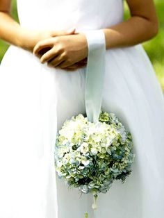 Flower Orb Cover a plastic-foam ball with fresh (or silk) flowers and hang it from a looped ribbon so the flower girl can carry it as she walks down the aisle.