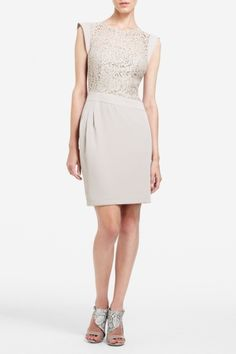 Luxe lace and asymmetrical details give fall style a sophisticated edge with this unique cocktail dress.