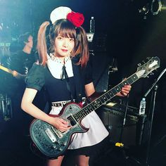 Miku from BAND-MAID with her new axe.