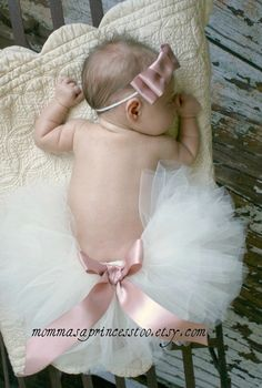 Love the tutu and bow.  I think I'm going to have to make this for our baby girl for her newborn pictures.