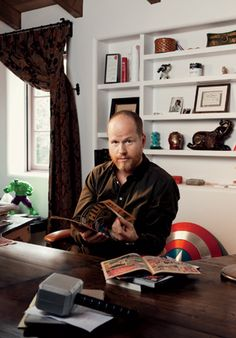 Joss Whedon, with Thor's hammer, Captain America's shield, and comic books aplenty, this links to an awesome GQ interview.