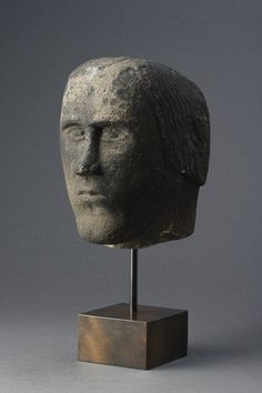 A Celtic Votive Head of a Man, Probably British, 200 to 300, possibly a local deity, intended for ritualistic purposes as part of the Celtic cult of the head. Veneration of the head was rooted in the Celtic religion, which regarded the head as the seat of soul and as capable of independent being.