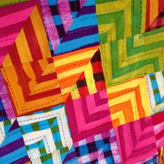 close-up of a quilt by malka dubrawsky, fabrics dyed using wax resist method