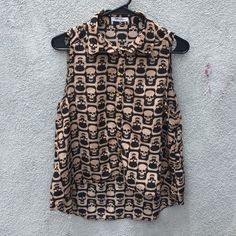 Button up skull blouse Button up skull blouse- gently worn. Slightly shorter in front. Tags not attached. Tops Blouses